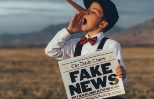 What is the main reason for spreading fake news?
